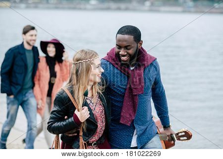 Young People Having Stroll On Beach