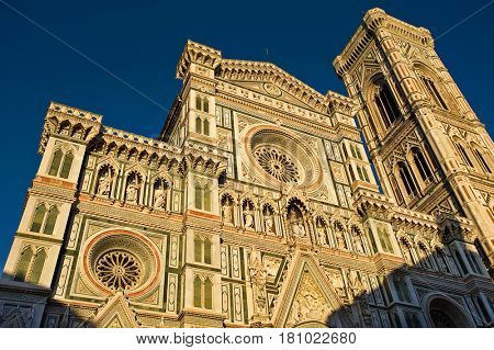 Florence, Italy - July 12, 2012: View on facade and dome of the Cathedral of Duomo Santa Maria Del Fiore in Florence,