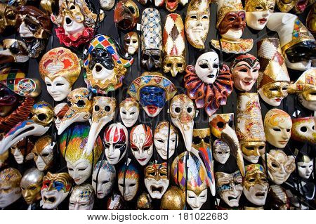 Venice, Italy - July 27, 2012: Venetian carnival masks in souvenir shop on a street of Venice, the Carnival of Venice is an annual festival held in Venice