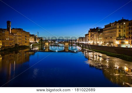 Florence, Italy - July 12, 2012: View of the Arno River Reflections and Florence skyline at night