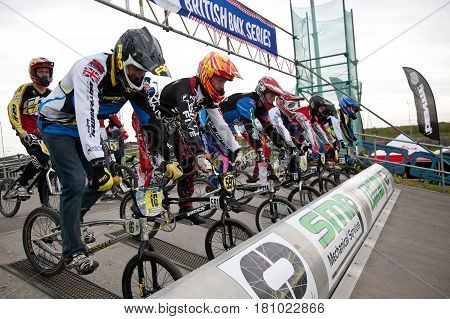 GRAVESEND, UK - APRIL 12: Riders competing in the adult class of the UK National BMX championships at the Kent cyclopark wait to go at the top of the start ramp on April 12, 2014 in Gravesend