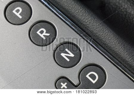 Detail of modern car interior. Close up of automatic transmission car. P R N D sign.