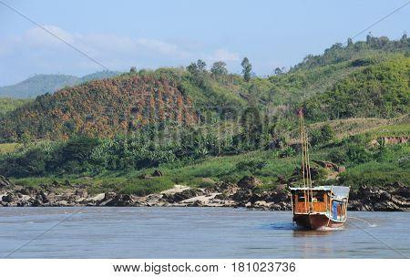 River Mekong, Laos - 8 January 2012: merchant ship in river Mekong on the way to Luang Prabang, Laos