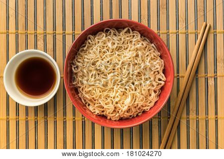 noodles with shoyu or sauce on bamboo or wood backgroound