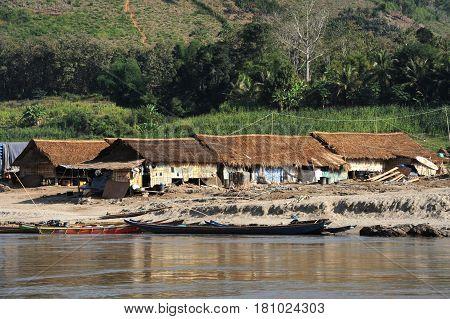 River Mekong, Laos - 7 January 2012: village on river Mekong on the way to Luang Prabang, laos