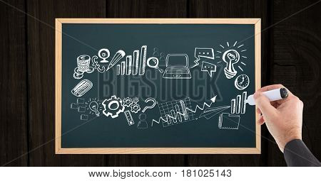 Digital composite of Hand drawing business concepts on slate
