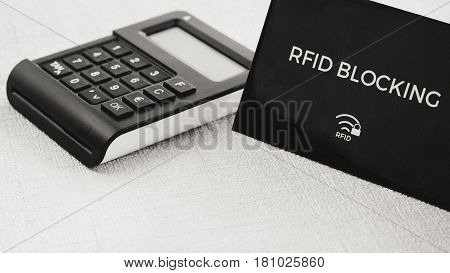 RFID protection sleeve for secure credit card from hacking attack or stealing money, TAN generator in middle ground