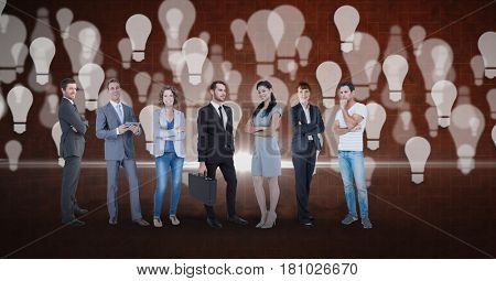 Digital composite of Digital composite image of business people with light bulb background