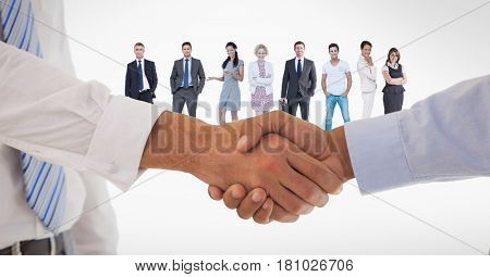Digital composite of Cropped image of business people doing handshake with employees in background
