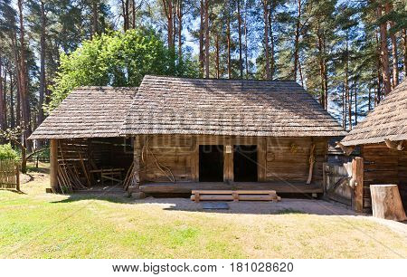 RIGA LATVIA - JUNE 13 2016: Two-part granary (barn for grain and storehouse for clothes circa 1819) of Delini farmstead of Kurzeme ethnic group. Exhibited in Ethnographic Open-Air Museum of Latvia since 1971