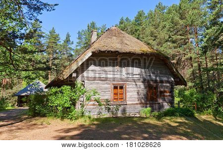 RIGA LATVIA - JUNE 13 2016: Dwelling rural house (circa 1851) of Celaji fishermen farmstead of Vidzeme ethnic group. Exhibited in Ethnographic Open-Air Museum of Latvia since 1966