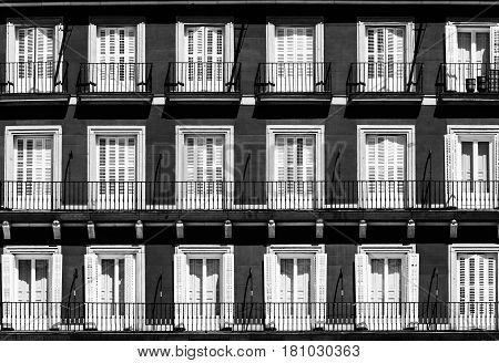 Madrid (Spain): facade of historic palace in Plaza Mayor the main square of the city. Black and white