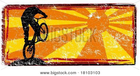 banner with silhouette of a man on mountain bike