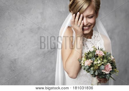 Young Funny bride laughing in studio portrait