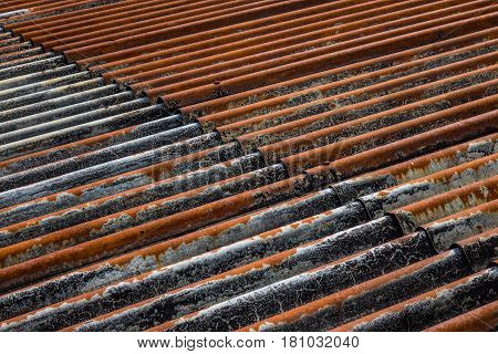 The Old And Rusty Iron Roof Of A Building