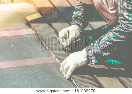 Carpenter Hand Or Hand Of Worker Marking On Wood Plate With Carpenter Pencil Marker In Work Shop.