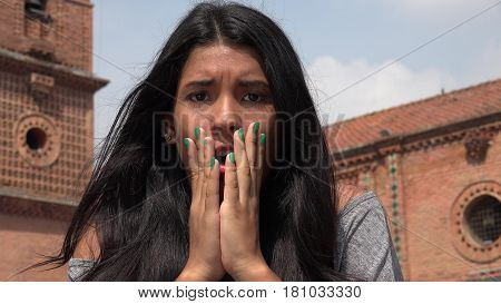 A Startled Person In Shock Covering Her Face