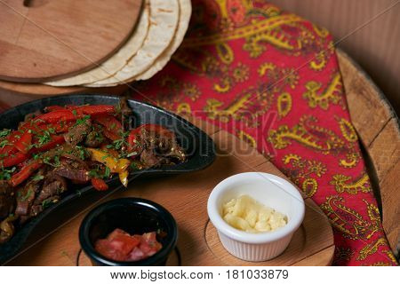 Mexican platillo Tacos of barbacoa and vegetarian with sauces and colorful table. mexican food tacos set.