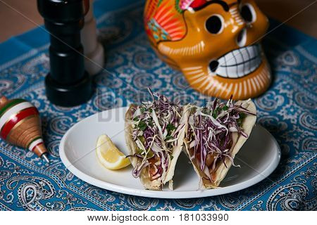 Mexican hot burritos stuffed with vegetables on abstract blue background.