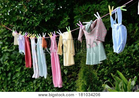 Old custom - baby clothes hanging on a clothesline as a gift for offspring