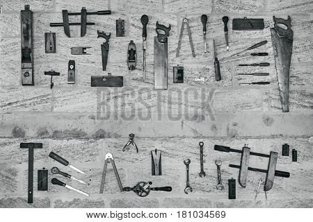 Set of Construction tools Many work tools isolated on stone background.