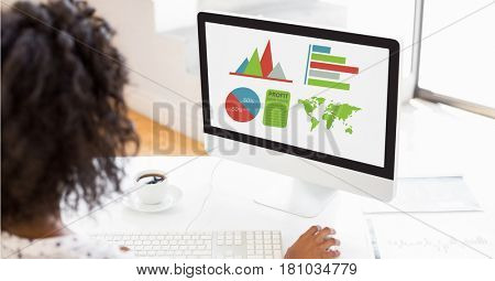 Digital composite of Businesswoman making graphs on computer