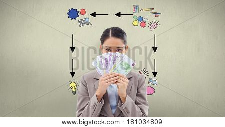 Digital composite of Businesswoman holding banknotes against signs on wall