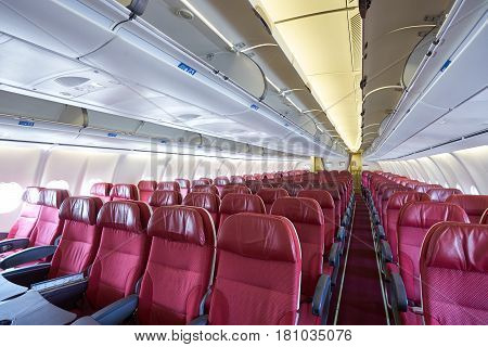 Seat rows in an airplane cabin. Interior of the passenger aircraft.