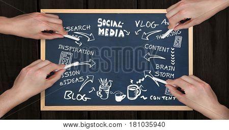Digital composite of Hands making social media diagram on slate