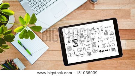 Digital composite of Overhead view of various formulas in digital tablet with diary by laptop and potted plant on wooden
