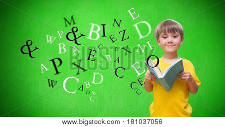 Digital composite of Digitally generated image of boy holding books with letters flying against green background