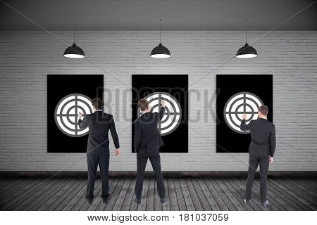 Digital composite of Rear view of businessmen setting targets