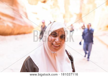 Muslim girl having good time walking outdoors