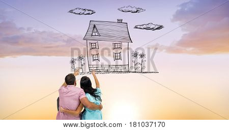 Digital composite of Digital composite image of couple pointing at dream house