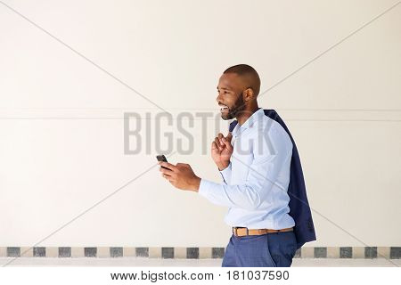 Young African Business Man Walking Outdoors With Mobile Phone