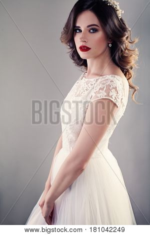 Nice Bride in White Wedding Dress Pretty Girl Fiancee with Curly Hair and Makeup on Background