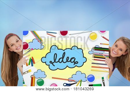 Digital composite of Portrait of women holding billboard with idea text and colorful drawing against sky