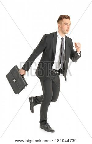 Handsome running businessman on white background