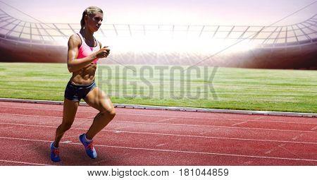 Digital composite of Full length of female athlete running on racing track