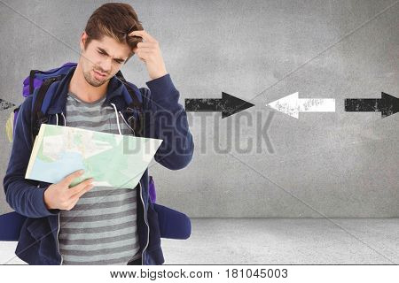 Digital composite of Confused male hiker reading map while standing against arrows in background