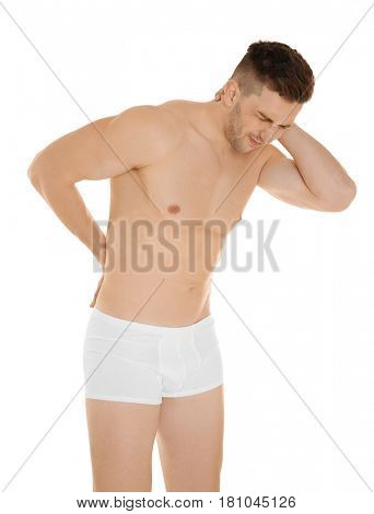 Young man suffering from back pain on white background