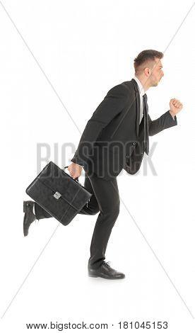 Handsome running businessman on white background