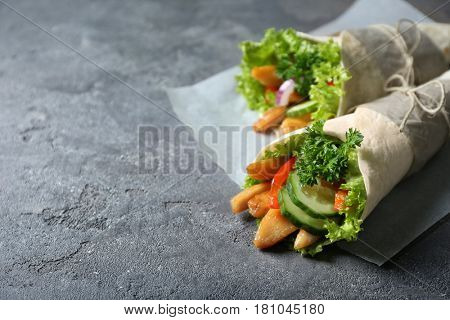 Delicious kebab sandwiches on grey table