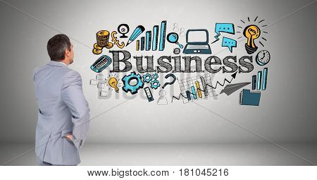 Digital composite of Businessman looking at business text with various icons against gray background