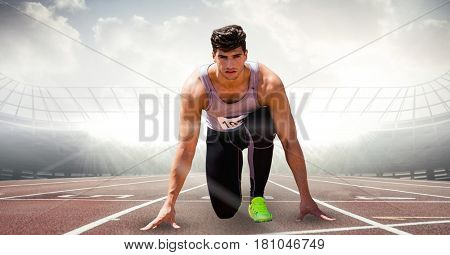 Digital composite of Digitally generated image of male athlete at starting point on racing track