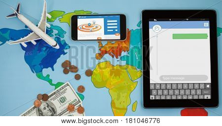 Digital composite of Overhead view of smart phone and tablet computer on world map with currency