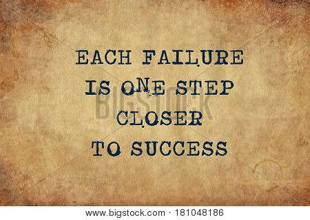 Inspiring motivation quote of each failure is one step closer to success with typewriter text. Distressed Old Paper with Typing image.