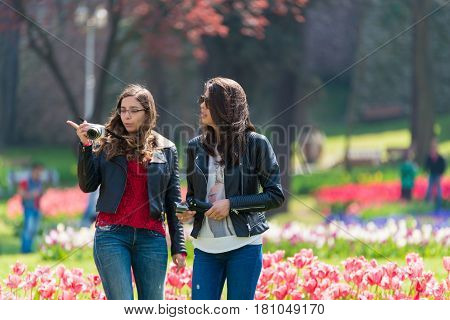 Istanbul,turkey - April 08, 2015: Tourist In A Garden Near Sultanahmet Square,the Sultanahmet Square