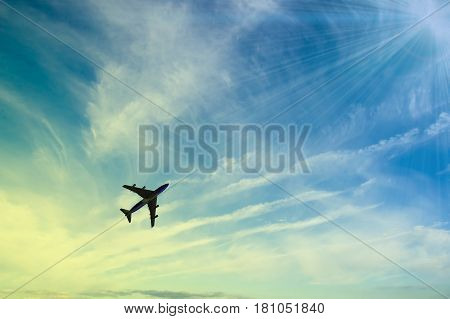 The plane flies in the sky against, the background of clouds