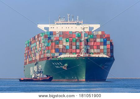 Rotterdam the Netherlands - April 9 2017: CSCL Venus container ship with tug boats in Rotterdam harbor